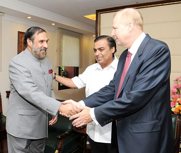 British Petroleum CEO Robert Dudley and Mukesh Ambani, meeting Commerce Minister Anand Sharma in New Delhi on September 28, 2011.