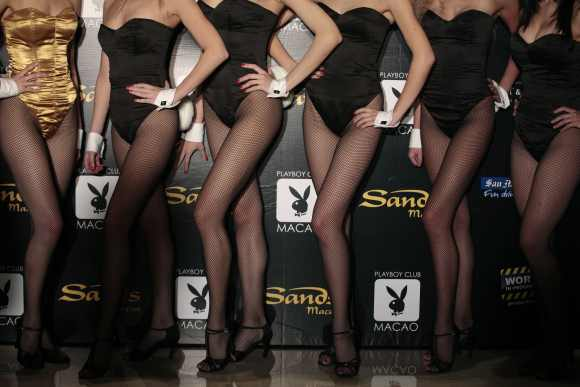Models pose for a picture during a promotional event for opening of the Playboy club in Macau