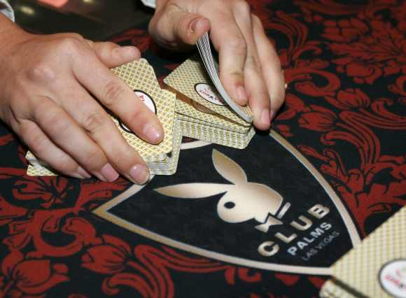 A dealer shuffles cards at a Playboy Club in Las Vegas