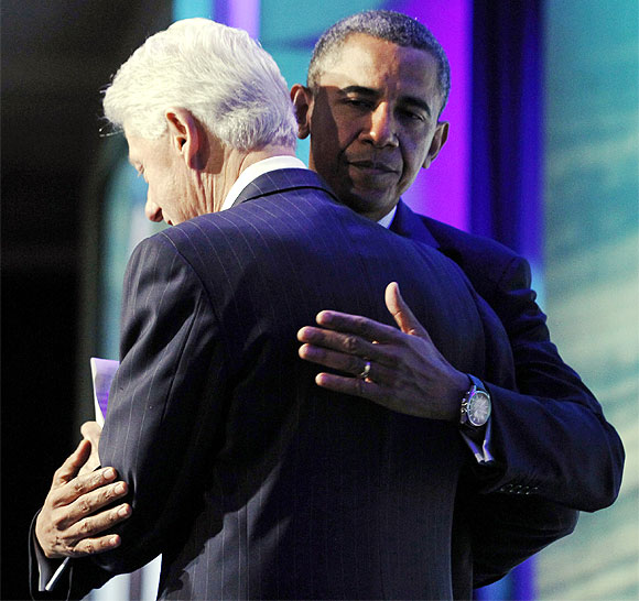 Obama hugs Bill Clinton