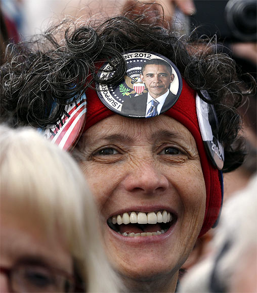 A supporter listens to Obama at a campaign event at Austin Straubel Airport International Airport in Green Bay, Wisconsin