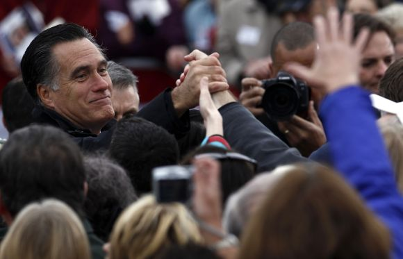 Republican presidential nominee Romney greets supporters at a campaign rally in Newington on Saturday