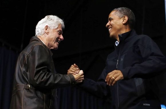 Bill Clinton introduces US President Obama during a campaign rally in Bristow, Virginia, on Saturday