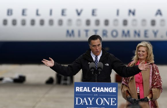 Mitt Romney and his wife Ann arrive at a campaign rally in Newington, New Hampshire, on Saturday