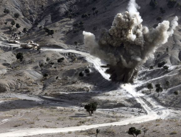 US soldiers blows up a roadside bomb set up by Taliban fighters near the town of Walli Was in Paktika province, near the border with Pakistan