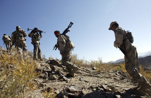 Afghan border policemen patrol during an operation near Walli Was in Paktika province, near the border with Pakistan