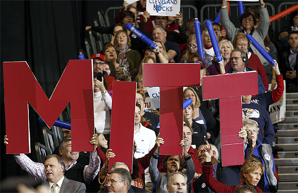 Supporters of Republican presidential nominee and former Massachusetts Governor Mitt Romney attend a campaign rally in Cleveland, Ohio