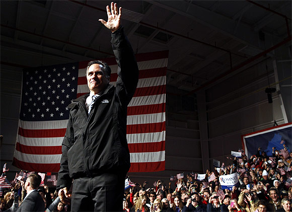 Romney arrives at a campaign rally in Newport News, Virginia