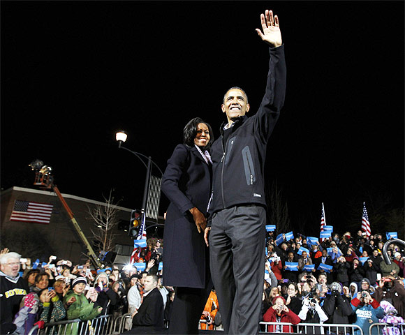 US President Barack Obama with First Lady Michelle Obama during his final presidential campaign rally in Des Moines, Iowa