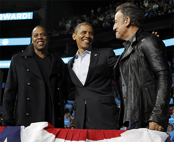US President Barack Obama with rapper Jay-Z and musician Bruce Springsteen at an election campaign rally