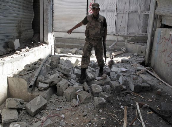 A Pakistani soldier surveys the site of a suicide blast in Swat Valley