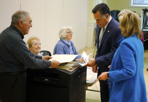 Republican presidential nominee Romney, with his wife Ann at his side, casts his ballot in Belmont