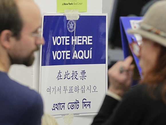 A sign directs voters during the U.S. presidential election at a displaced polling center in the Coney Island section of Brooklyn, New York