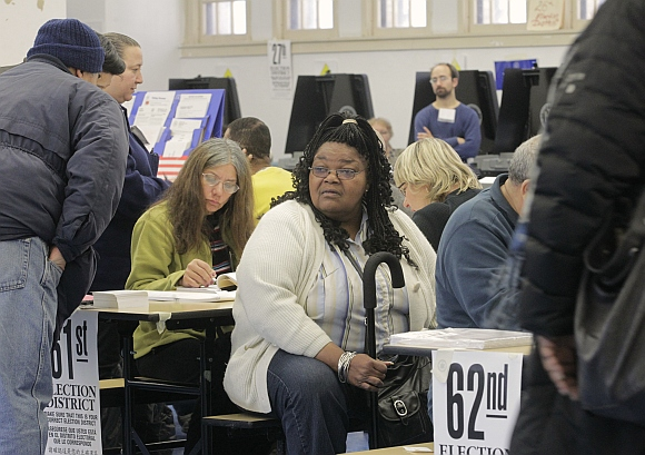 A voter waits for her turn to vote in the US presidential election at a displaced polling center in the Coney Island section of Brooklyn, New York