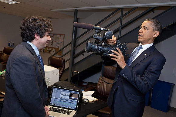 US President Barack Obama jokingly pretends to tape Chaudhary backstage before a town hall meeting at ElectraTherm, Inc in Reno, Nevada