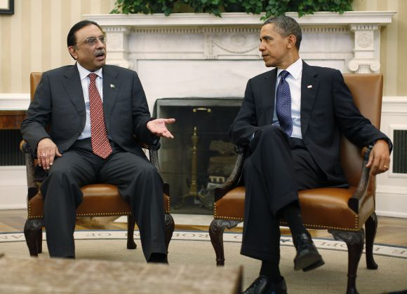 Barack Obama meets with Pakistan's President Asif Ali Zardari in the Oval Office of the White House in Washington