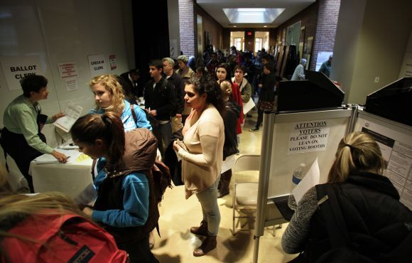 People wait to vote during the US presidential election at the School Without Walls polling station in Washington on Tuesday.