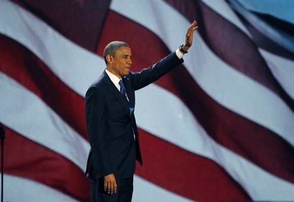 Obama, who won a second term in office by defeating Republican presidential nominee Mitt Romney, waves as he addresses supporters during his election night victory rally in Chicago.