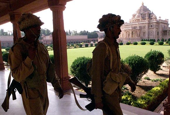Border Security Force personnel patrol the Akshardham temple complex after commandos flushed out gunmen from inside in Gandhinagar, on September 25, 2002