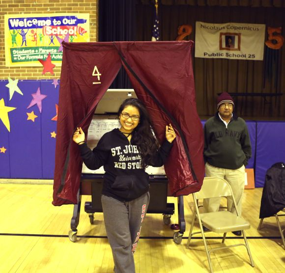 An Indian American is seen after casting her vote at a polling booth in Sandy-hit Jersey City on Tuesday