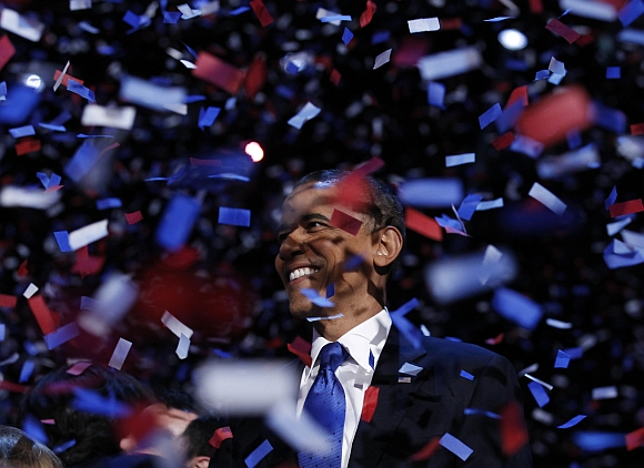 Obama celebrates on stage as confetti falls after his victory speech during his election rally in Chicago