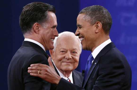 US President Barack Obama and Republican presidential nominee Mitt Romney shake hands at the start of the final presidential debate at Lynn University in Boca Raton, Florida October 22, 2012. At center is moderator Bob Schieffer.