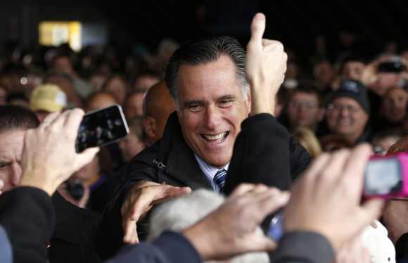 US Republican presidential nominee and former Massachusetts Governor Mitt Romney greets supporters at a campaign rally in Dubuque, Iowa