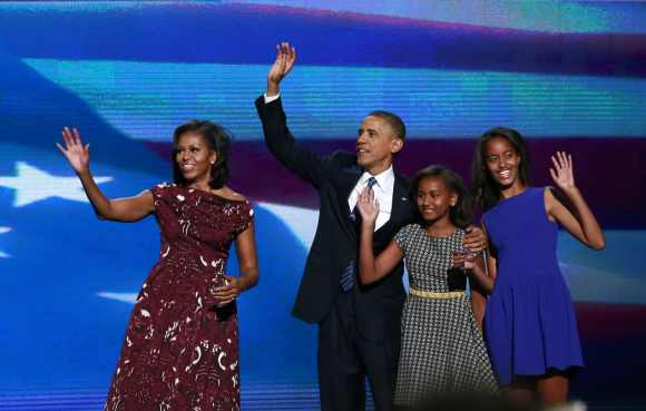 Obama is joined onstage by first lady Michelle Obama and his daughters Sasha and Malia