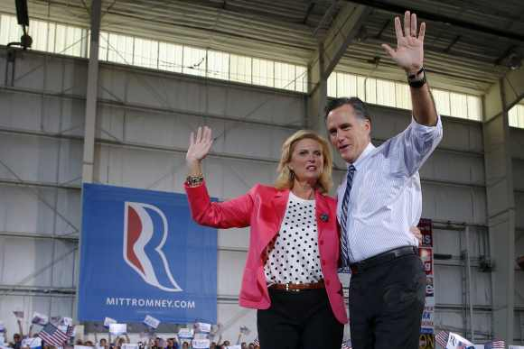 Romney and his wife Ann wave to the crowd at a campaign rally in Colorado Springs, Colorado