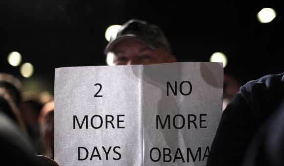 A supporter of Romney attends a campaign rally in Des Moines, Iowa