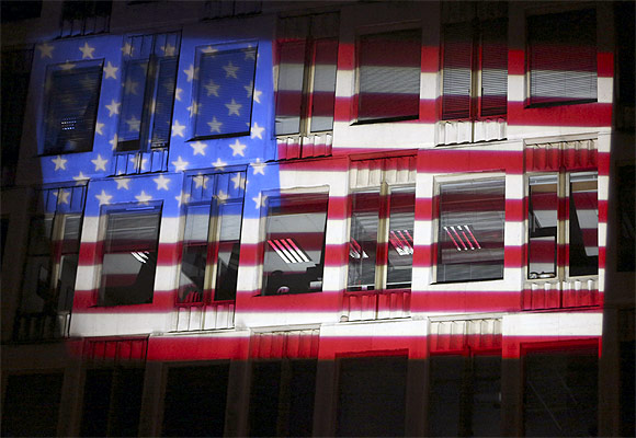 America's national flag is projected on the facade of the US embassy in London to mark the US polls
