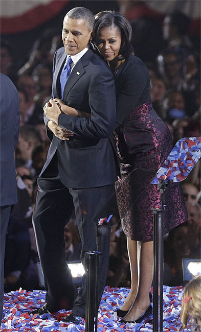 US President Barack Obama is embraced by first lady Michelle Obama after his victory speech during his election night rally in Chicago