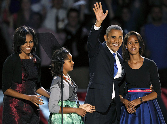 Obama waves with his daughters Malia and Sasha and wife Michelle during his election night victory rally in Chicago