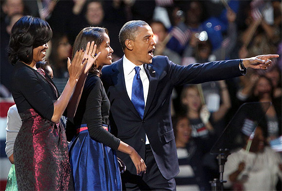 Obama with his family at the rally in Chicago