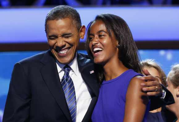 US President Barack Obama celebrates with his daughter Malia after accepting the 2012 USDemocratic presidential nomination in North Carolina