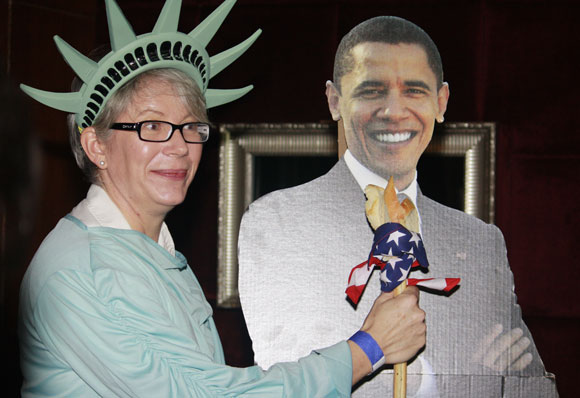 Yet another consular officer dresses up as Lady Liberty and raises a toast (literally) for Obama