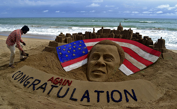 A sand sculpture of US President Barack Obama on a beach at Puri