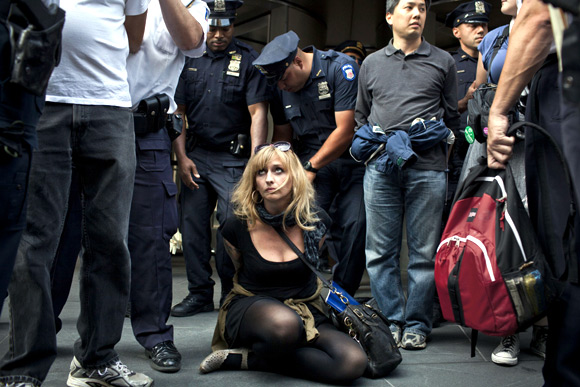 An Occupy Wall Street activist is arrested while protesting in the streets of New York's financial district