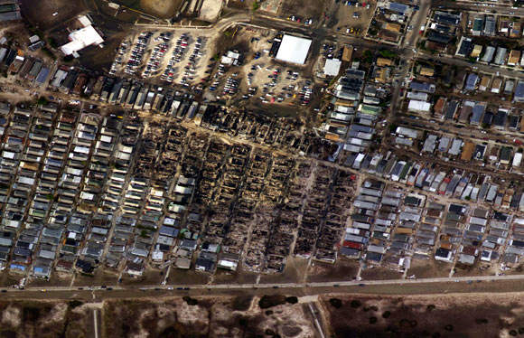 Burnt houses surrounded by houses that survived is seen in the aftermath of Hurricane Sandy in the Breezy Point neighbourhood of Queens, New York