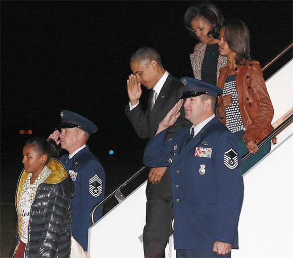 US President Barack Obama, First Lady Michelle Obama and their daughters Malia and Sasha  arrive at Andrews Air Force Base near Washington
