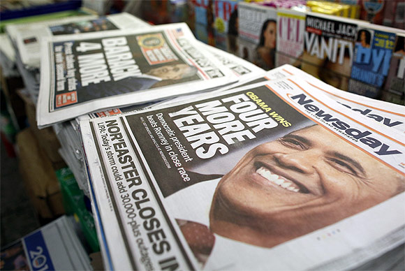 A view shows newspapers with Barack Obama winning the US presidential election on their frontpages, at a news stand in Times Square