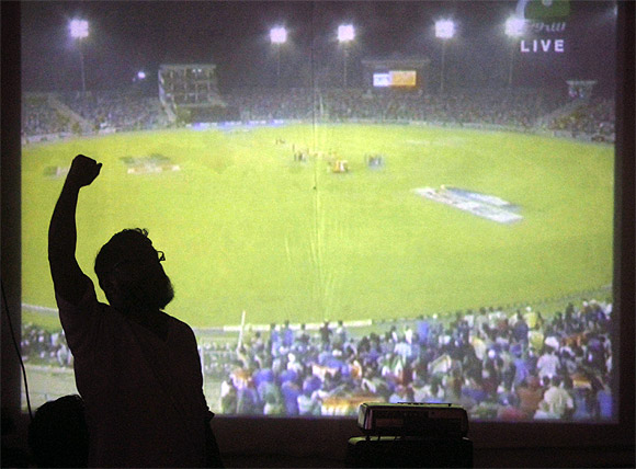 Cricket fans celebrate after India's victory