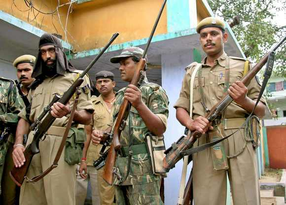 Policemen stand guard in the Gaya area of Bihar