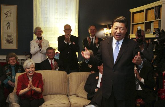 China's Vice President Xi Jinping speaks at the home of Roger and Sarah Lande in Muscatine, Iowa. Xi joked about receiving a gift of popcorn during his first visit to Muscatine in 1985.