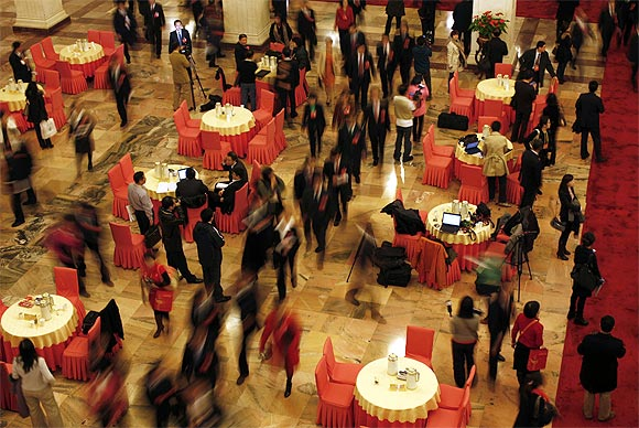 Delegates walk through a hall inside the Great Hall of the People
