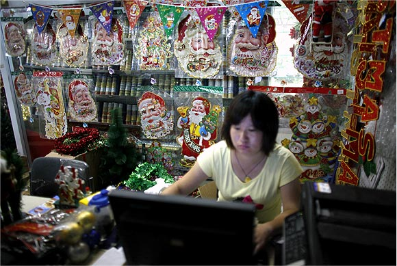 A woman works on a computer at a Christmas decoration shop in Yiwu, Zhejiang province