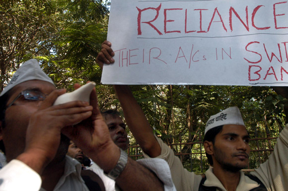 India against Corruption activists raise slogans against the Ambanis outside their south Mumbai residence