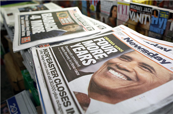 A view shows newspapers with Barack Obama winning the US presidential election on their frontpages, at a news stand in Times Square, New York