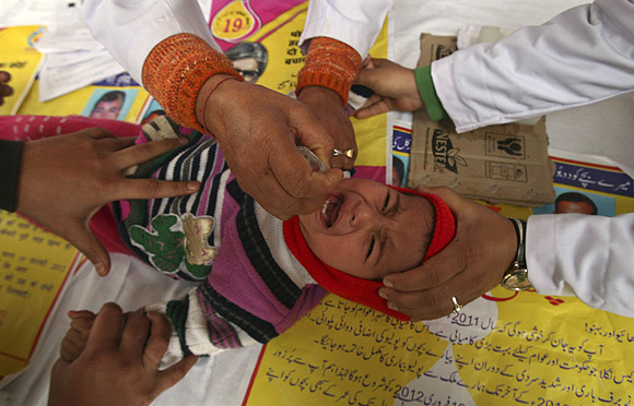 A child receives polio drops during a polio eradication programme in Jammu