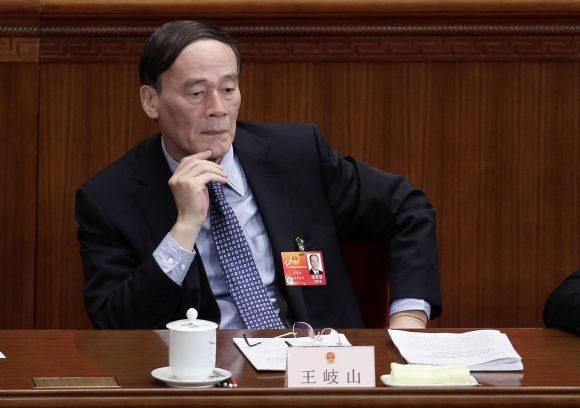 Wang Qishan attends a plenary meeting of the National People's Congress, at the Great Hall of the People in Beijing. Photograph: Jason Lee/Reuters